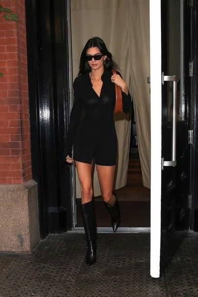 Kendall Jenner shows off her taut tummy in a white crop